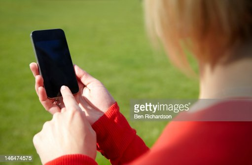 Using Smartphone outside : Stock Photo