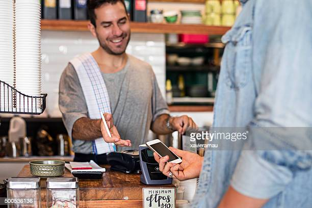 Using the contactless mobile phone payment in the cafeteria