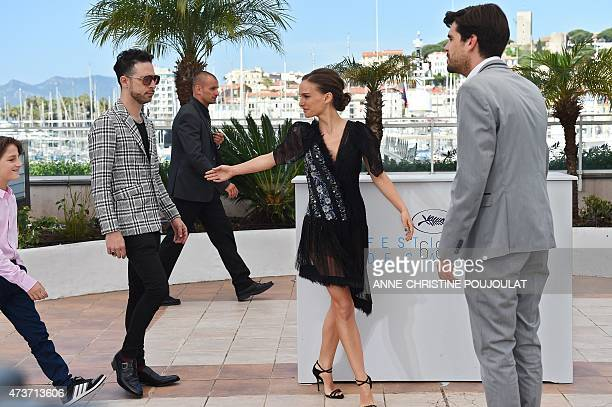 USIsraeli actress and director Natalie Portman poses with Israeli actors Gilad Kahana and Amir Tessler during a photocall for the film 'A Tale of...