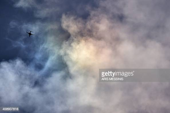A USled coalition B1b flies on November 13 2014 over the Syrian city of Kobane also known as Ain alArab as seen from the Turkish border village of...