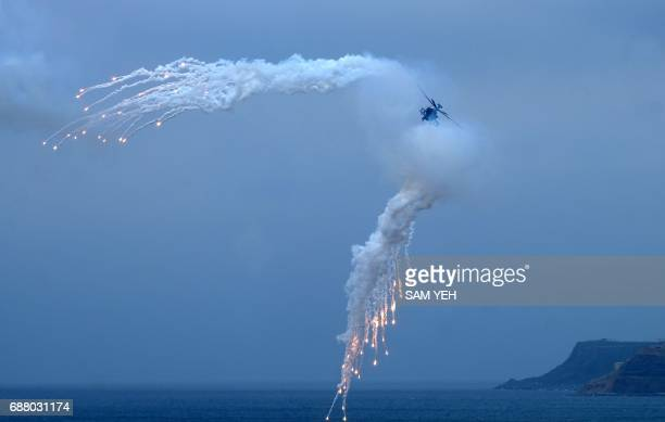 USmade Apache helicopter releases flares during the 'Han Kuang' lifefire drill some 7 kms from the city of Magong on the outlying Penghu islands on...
