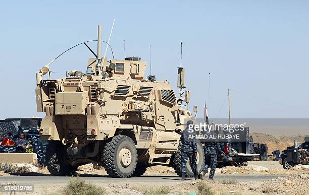 USmade armored combat vehicle is seen parked at the Qayyarah military base about 60 kilometres south of Mosul on October 16 as they prepare for an...