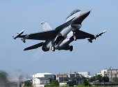 A USmade F16 jet fighter takes off from a highway in southern Chiayi county during the annual Han Kuang drill on September 16 2014 Taiwan displayed...