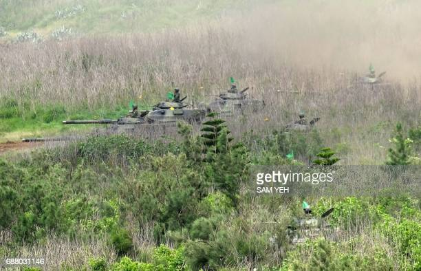 USmade M60 A3 tanks sit parked amongst the terrain during the 'Han Kuang' lifefire drill some 7 kms from the city of Magong on the outlying Penghu...
