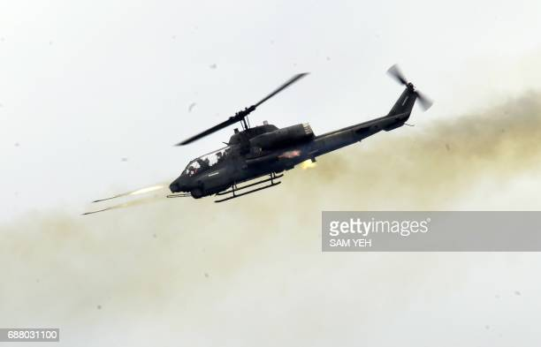 A USmade Super Cobra helicopter launches rockets during the 'Han Kuang' lifefire drill some 7 kms from the city of Magong on the outlying Penghu...