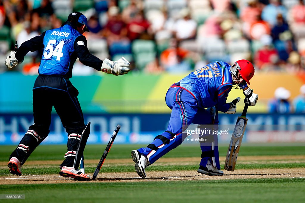 Usman Ghani of Afghanistan is bowled by Daniel Vettori of New Zealand during the 2015 ICC Cricket World Cup match between New Zealand and Afghanistan...