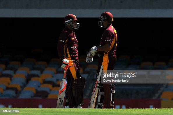 Usman Khajawa and Chris Hartley of the Bulls talk during the Matador BBQs One Day Cup match between Queensland and Victoria at The Gabba on October 4...