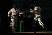 Usman Khawaja and Joe Burns of Queensland run between the wickets during day three of the Sheffield Shield match between Victoria and Queensland at...