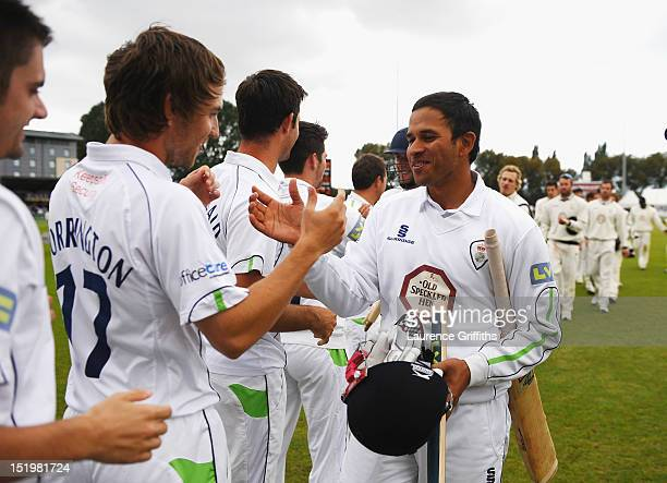 Usman Khawaja and Ross Whiteley of Derbyshire celebrate victory and the title during the LV County Championship match between Derbyshire and...