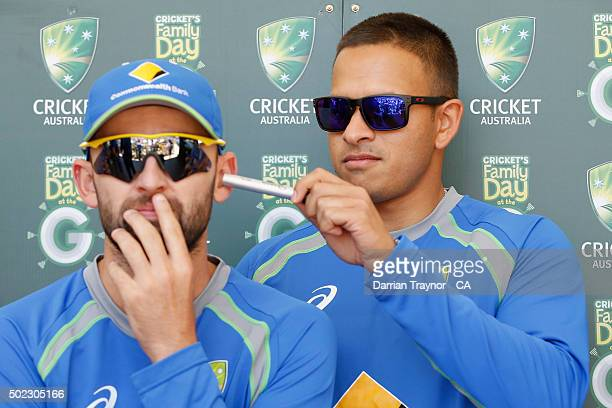 Usman Khawaja has some fun with Nathan Lyon during the Family Day At The G at Melbourne Cricket Ground on December 23 2015 in Melbourne Australia