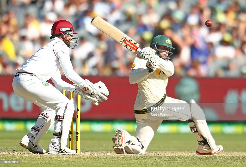 <a gi-track='captionPersonalityLinkClicked' href=/galleries/search?phrase=Usman+Khawaja&family=editorial&specificpeople=4953179 ng-click='$event.stopPropagation()'>Usman Khawaja</a> of Australia bats as wicketkeeper <a gi-track='captionPersonalityLinkClicked' href=/galleries/search?phrase=Denesh+Ramdin&family=editorial&specificpeople=542842 ng-click='$event.stopPropagation()'>Denesh Ramdin</a> of the West Indies looks on during day three of the Second Test match between Australia and the West Indies at the Melbourne Cricket Ground on December 28, 2015 in Melbourne, Australia.