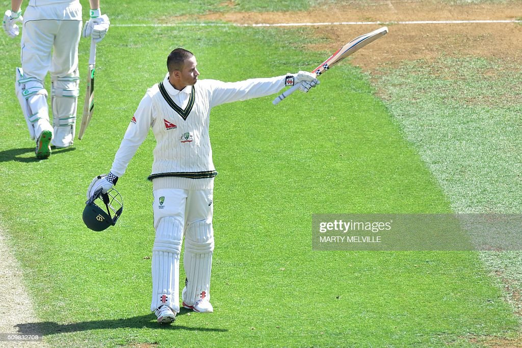 Usman Khawaja of Australia celebrates 100 runs during day two of the first cricket Test match between New Zealand and Australia at the Basin Reserve in Wellington on February 13, 2016. / AFP / Marty Melville