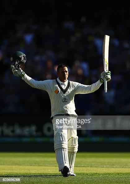 Usman Khawaja of Australia celebrates after reaching his century during day two of the Third Test match between Australia and South Africa at...