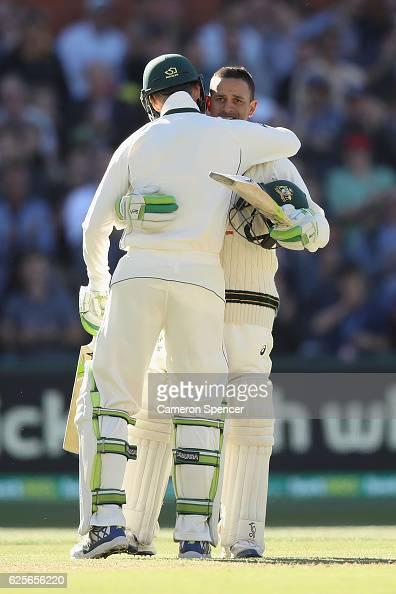 Usman Khawaja of Australia celebrates after scoring a century with team mate Peter Handscomb of Australia during day two of the Third Test match...