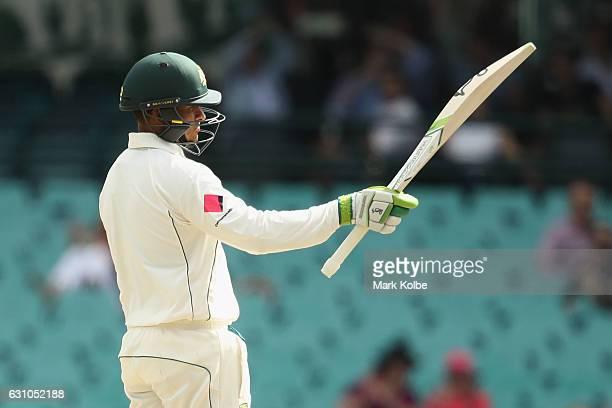 Usman Khawaja of Australia celebrates his half century during day four of the Third Test match between Australia and Pakistan at Sydney Cricket...