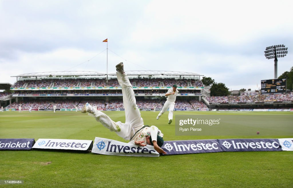 <a gi-track='captionPersonalityLinkClicked' href=/galleries/search?phrase=Usman+Khawaja&family=editorial&specificpeople=4953179 ng-click='$event.stopPropagation()'>Usman Khawaja</a> of Australia dives to save a boundary during day three of the 2nd Investec Ashes Test match between England and Australia at Lord's Cricket Ground on July 20, 2013 in London, England.