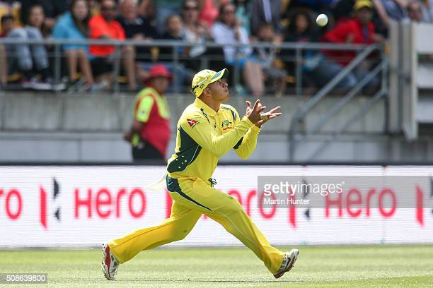Usman Khawaja of Australia holds a catch to dismiss Martin Guptill of New Zealand during game two of the one day international series between New...