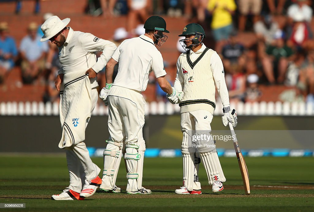 <a gi-track='captionPersonalityLinkClicked' href=/galleries/search?phrase=Usman+Khawaja&family=editorial&specificpeople=4953179 ng-click='$event.stopPropagation()'>Usman Khawaja</a> of Australia is congratulated by <a gi-track='captionPersonalityLinkClicked' href=/galleries/search?phrase=Adam+Voges&family=editorial&specificpeople=724770 ng-click='$event.stopPropagation()'>Adam Voges</a> of Australia after he leadched his half century during day one of the Test match between New Zealand and Australia at Basin Reserve on February 12, 2016 in Wellington, New Zealand.