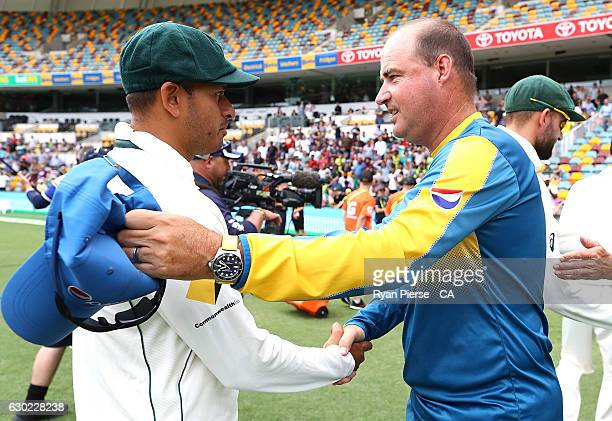 Usman Khawaja of Australia is congratulted by Micky Arthur coach of Pakistan during day five of the First Test match between Australia and Pakistan...