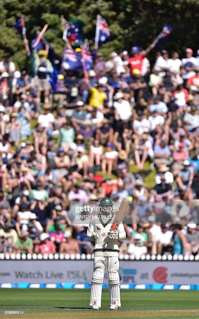 Usman Khawaja of Australia (Bottom) is supported by Australian fans in the crowd (Top) during the first cricket Test match between New Zealand and Australia at the Basin Reserve in Wellington on February 12, 2016. AFP PHOTO / MARTY MELVILLE / AFP / Marty Melville