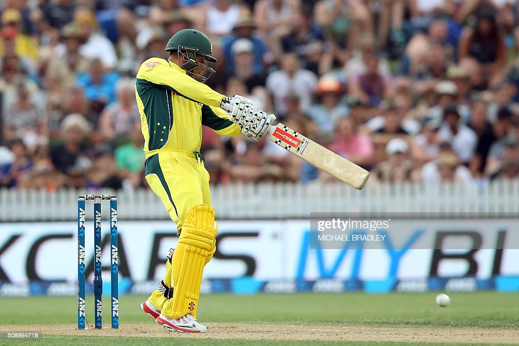 Usman Khawaja of Australia plays a shot during the third one-day international cricket match between New Zealand and Australia at Seddon Park in Hamilton on February 8, 2016.   AFP PHOTO / MICHAEL BRADLEY / AFP / MICHAEL BRADLEY