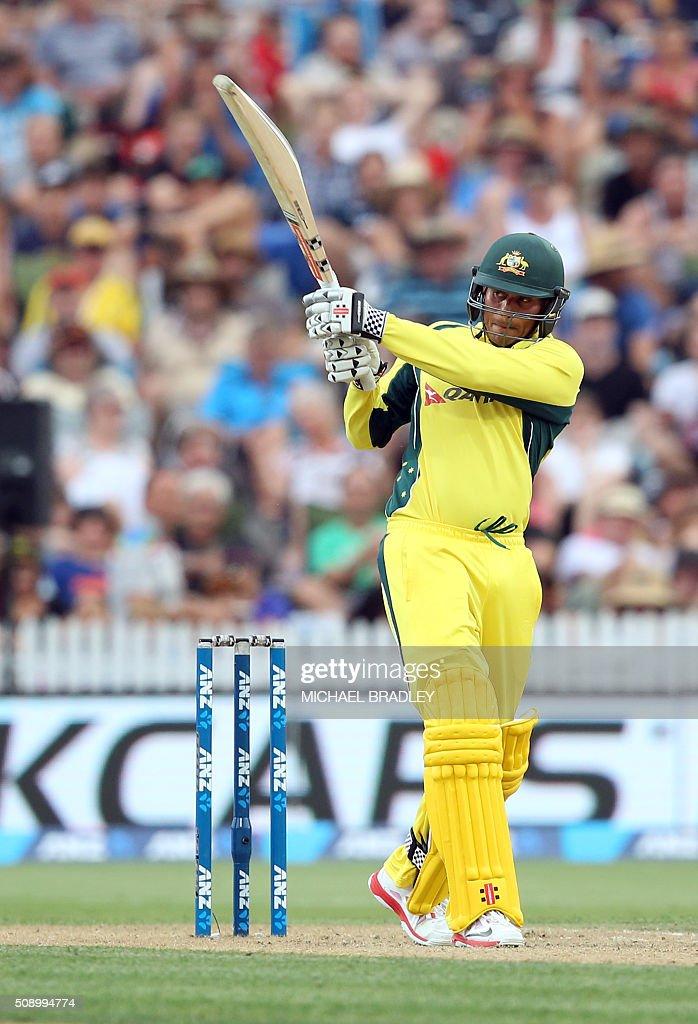 Usman Khawaja of Australia plays a shot during the third one-day international cricket match between New Zealand and Australia at Seddon Park in Hamilton on February 8, 2016. AFP PHOTO / MICHAEL BRADLEY / AFP / MICHAEL BRADLEY