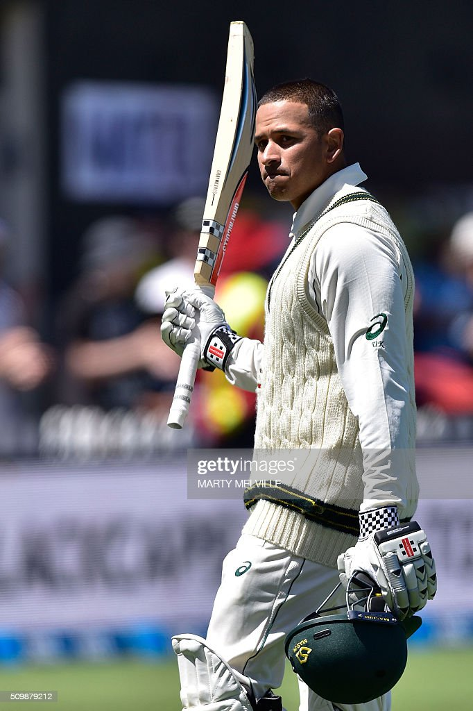 Usman Khawaja of Australia walks from the field after being caught with LBW during day two of the first cricket Test match between New Zealand and Australia at the Basin Reserve in Wellington on February 13, 2016. AFP PHOTO / MARTY MELVILLE / AFP / Marty Melville