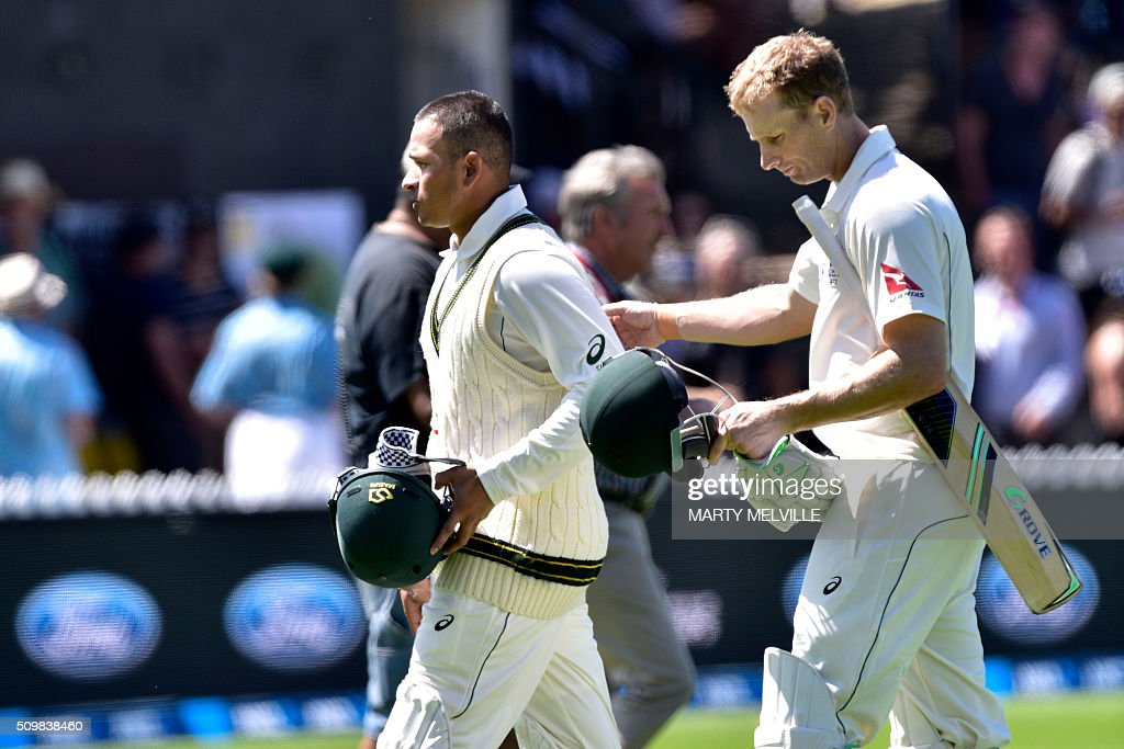 Usman Khawaja (L) of Australia with teammate Adam Voges walk from the field for lunch during day two of the first cricket Test match between New Zealand and Australia at the Basin Reserve in Wellington on February 13, 2016. AFP PHOTO / MARTY MELVILLE / AFP / Marty Melville