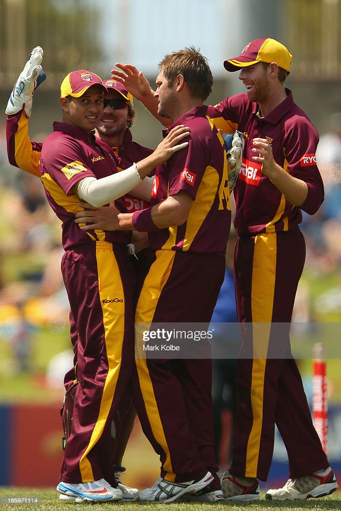 Usman Khawaja of the Bulls celebrates with his team mates after taking a catch to dimiss Steve Smith of the Blues during the Ryobi Cup Final match between the Queensland Bulls and the New South Wales Blues at North Sydney Oval on October 27, 2013 in Sydney, Australia.