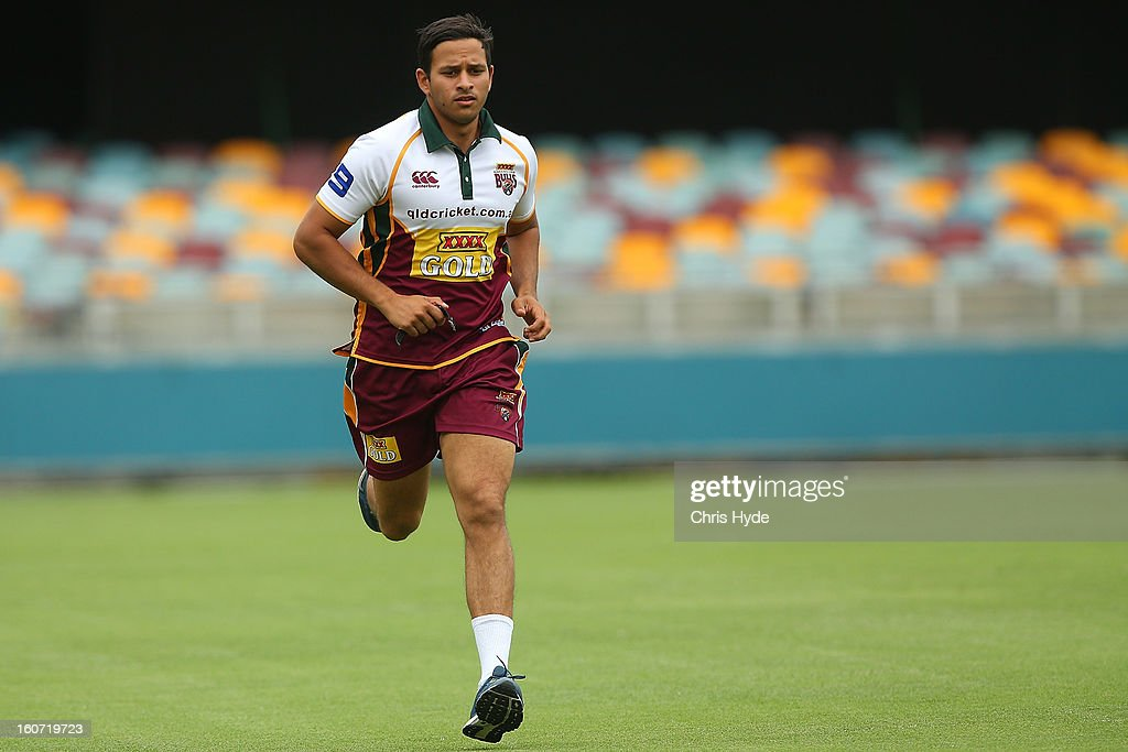 Usman Khawaja of the Bulls warms up during the lunch break during day two of the Sheffield Shield match between the Queensland Bulls and the Western Australia Warriors at The Gabba on February 5, 2013 in Brisbane, Australia.