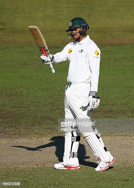 Usman Khawaja of the CA XI celebrates a century during the tour match between the Cricket Australia XI and New Zealand at Manuka Oval on October 24...