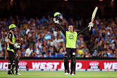 Usman Khawaja of the Sydney Thunder celebrates reaching 100 runs during the Big Bash League Semi Final match between the Adelaide Strikers and the...