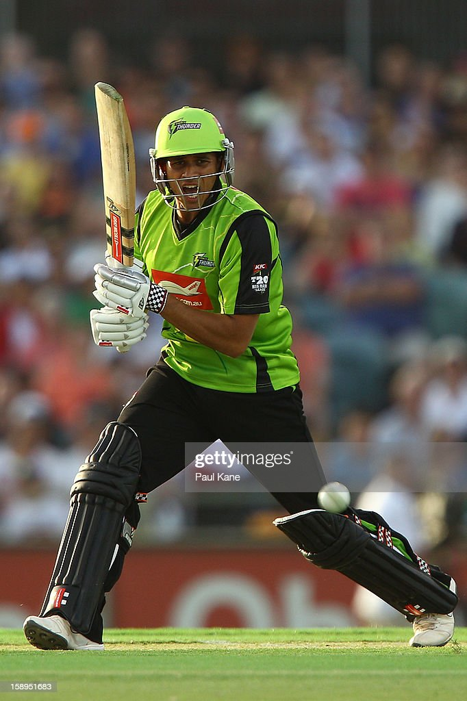 <a gi-track='captionPersonalityLinkClicked' href=/galleries/search?phrase=Usman+Khawaja&family=editorial&specificpeople=4953179 ng-click='$event.stopPropagation()'>Usman Khawaja</a> of the Thunder bats during the Big Bash League match between the Perth Scorchers and the Sydney Thunder at WACA on January 4, 2013 in Perth, Australia.