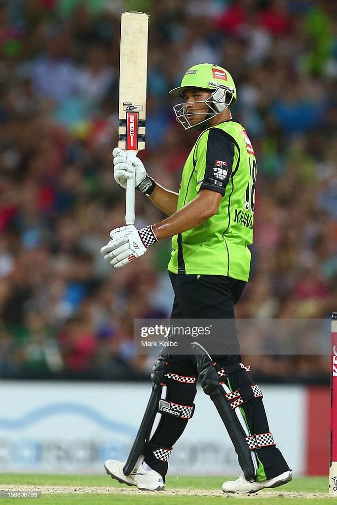 <a gi-track='captionPersonalityLinkClicked' href=/galleries/search?phrase=Usman+Khawaja&family=editorial&specificpeople=4953179 ng-click='$event.stopPropagation()'>Usman Khawaja</a> of the Thunder celebrates his half century during the Big Bash League match between Sydney Thunder and the Sydney Sixers at ANZ Stadium on December 30, 2012 in Sydney, Australia.