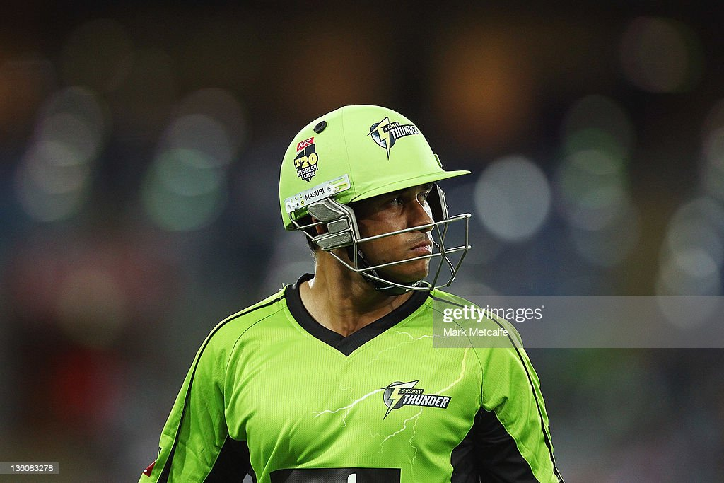 <a gi-track='captionPersonalityLinkClicked' href=/galleries/search?phrase=Usman+Khawaja&family=editorial&specificpeople=4953179 ng-click='$event.stopPropagation()'>Usman Khawaja</a> of the Thunder walks from the field of play after being dismissed during the T20 Big Bash League match between the Sydney Thunder and the Adelaide Strikers at ANZ Stadium on December 23, 2011 in Sydney, Australia.