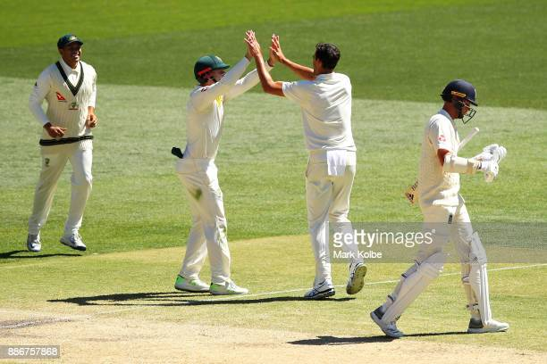 Usman Khawaja Shaun Marsh and Mitchell Starc of Australia celebrate the wicket of Stuart Broad of England as he leaves the field after being...