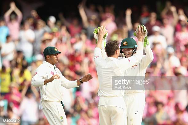 Usman Khawaja Steve O'Keefe and Peter Handscomb of Australia celebrate the dismissal of Asad Shafiq of Pakistan during day three of the Third Test...
