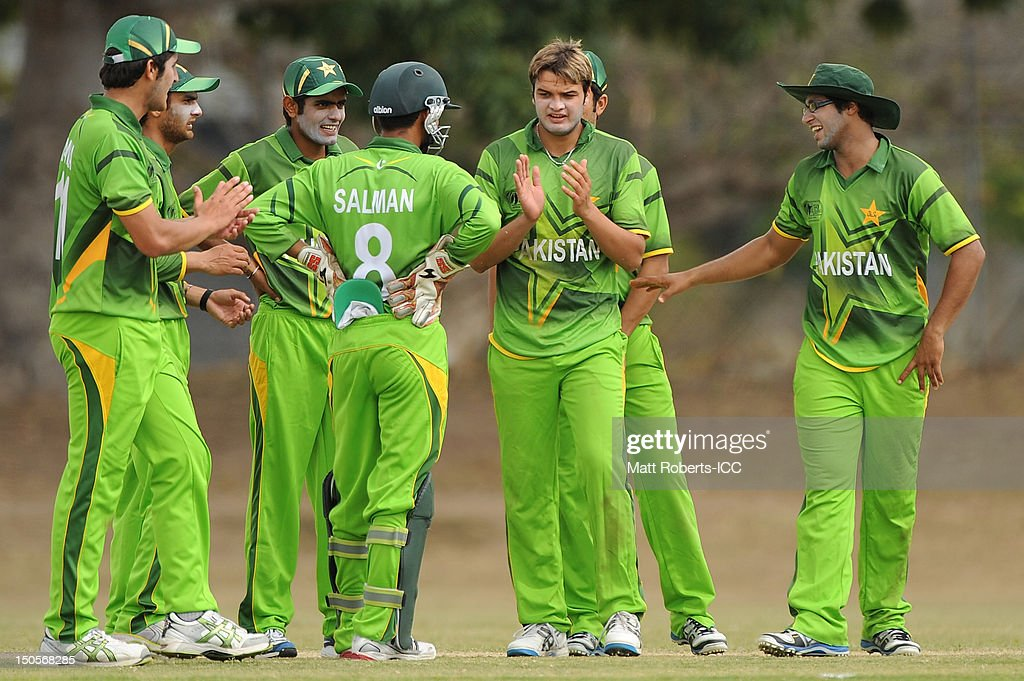 Usman Qadir (C) of Pakistan celebrates a wicket with team team mates during the ICC U19 Cricket World Cup 2012 Semi Final match between Pakistan and the West Indies at Endeavour Park on August 22, 2012 in Townsville, Australia.