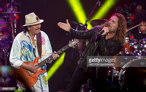 USMexican musician Carlos Santana performs Mexican singer Fer of band Mana during the Santana and Special Guests concert in Guadalajara on December...