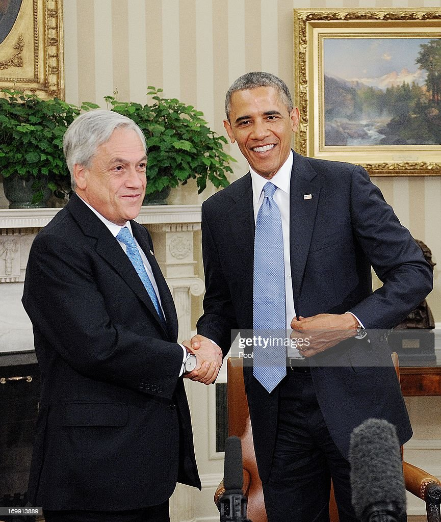 President <a gi-track='captionPersonalityLinkClicked' href=/galleries/search?phrase=Barack+Obama&family=editorial&specificpeople=203260 ng-click='$event.stopPropagation()'>Barack Obama</a> (R) meets with Chilean President Sebastián Piñera in the Oval Office of the White House June 4 , 2013 in Washington, DC. Obama and Piñera spoke about an Asia-Pacific freetrade agreement and other regional issues.