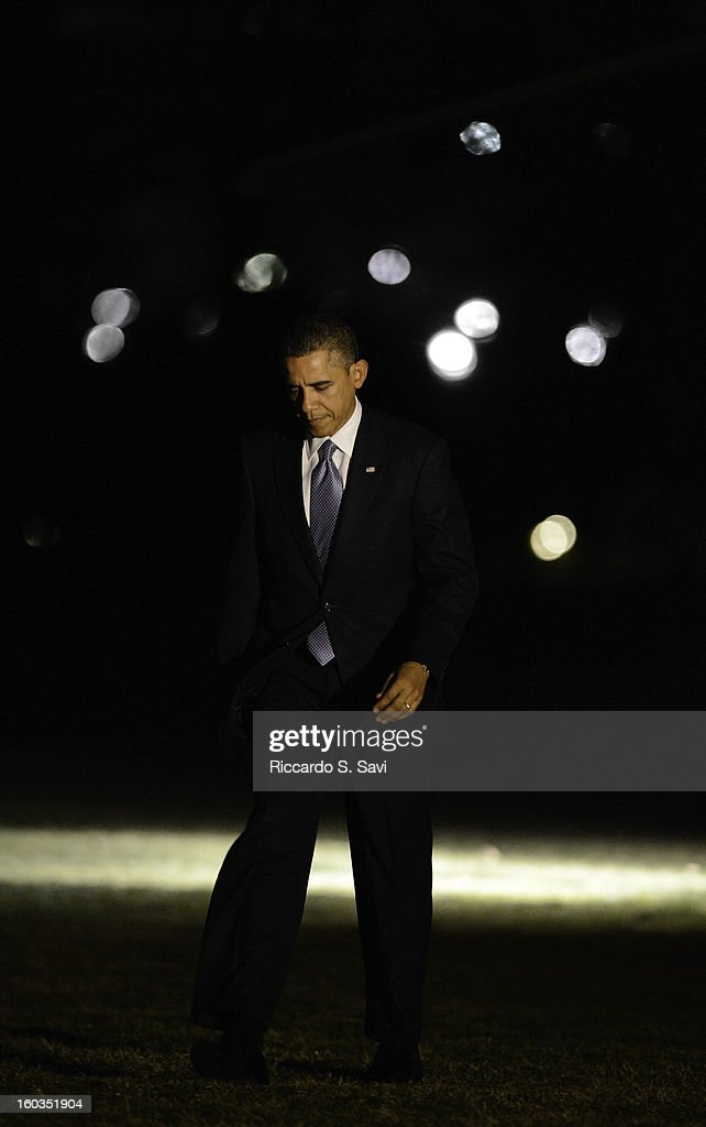 U.S.President <a gi-track='captionPersonalityLinkClicked' href=/galleries/search?phrase=Barack+Obama&family=editorial&specificpeople=203260 ng-click='$event.stopPropagation()'>Barack Obama</a> returns to the South Lawn of the White House after speaking in Las Vegas on comprehensive immigration reform on January 29, 2013 in Washington, DC.