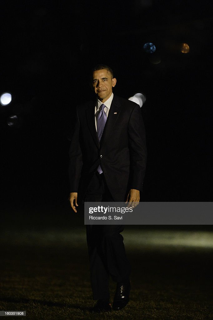 U.S.President Barack Obama returns to the South Lawn of the White House after speaking in Las Vegas on comprehensive immigration reform on January 29, 2013 in Washington, DC.