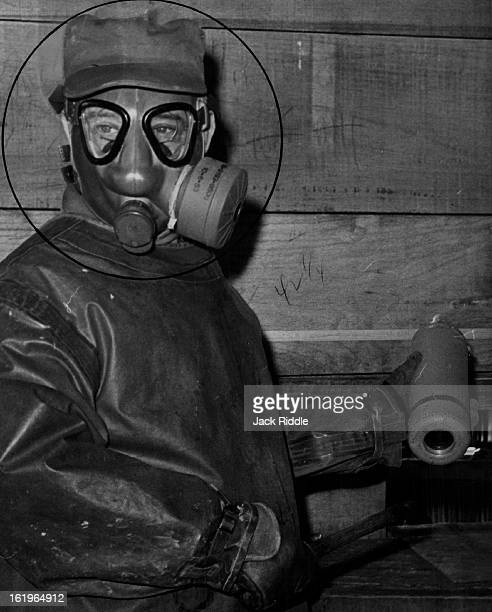 SRocky Mountain Arsenal This man's life is in danger The gas mask he wears offers some protection but there are other dangers in the delicate task he...