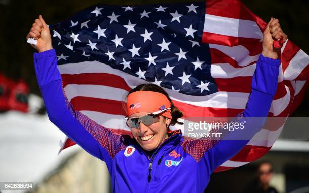 Us's Susan Dunklee celebrates with the US flag after placing second at the 2017 IBU World Championships Biathlon Women's 125 km Mass start race in...
