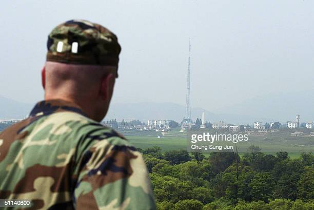 Ssoldier looks over North Korea as they stand guard at the check point in the demilitarized on August 4 2004 in South Korea North Korea is reportedly...