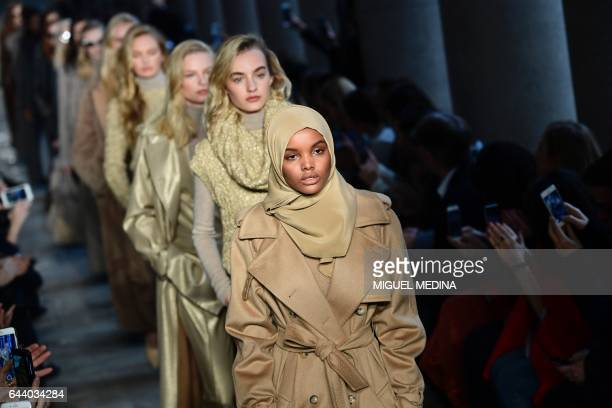 Somalia model Halima Aden presents a creation for fashion house Max Mara during the Women's Fall/Winter 2017/2018 fashion week in Milan on February...