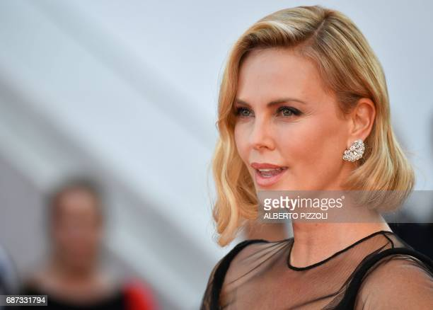 USSouth African actress Charlize Theron poses as she arrives on May 23 2017 for the '70th Anniversary' ceremony of the Cannes Film Festival in Cannes...