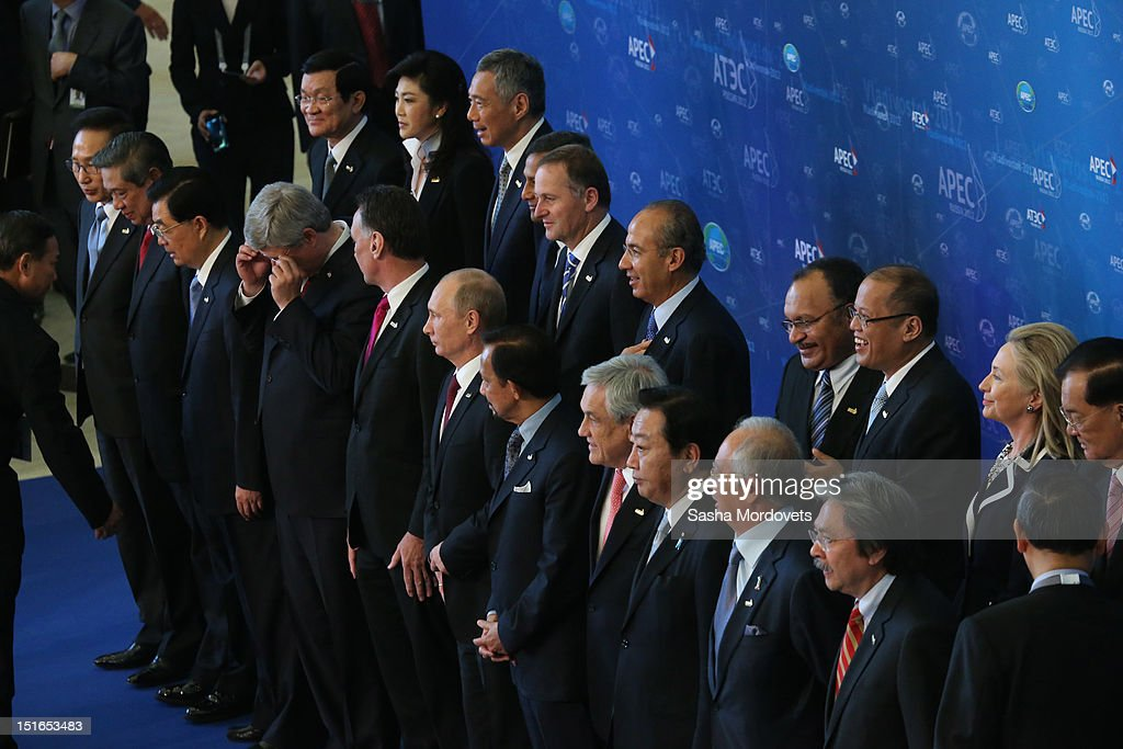 U.S.State Secretary Hillary Clinton (2nd R), Russian President Vladimir Putin (C) and other APEC leaders pose for a group photo during the session of the Summit of Asian Pacific Economic Cooperation (APEC) Summit September 9, 2012 in Vladivostok, Russia. Leaders of APEC countries are gathered at Russky Island in Vladivostok to seek freer trade among member nations.