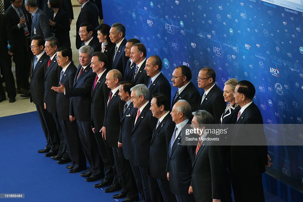 U.S.State Secretary Hillary Clinton (2nd R, backrow), Russian President Vladimir Putin (C) and other APEC leaders pose for a group photo during the session of the Summit of Asian Pacific Economic Cooperation (APEC) Summit September 9, 2012 in Vladivostok, Russia. Leaders of APEC countries are gathered at Russky Island in Vladivostok to seek freer trade among member nations.