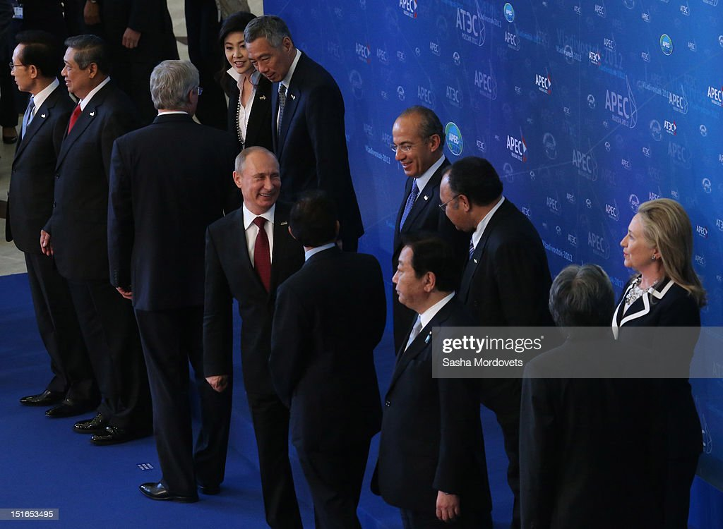 U.S.State Secretary Hillary Clinton (R), Russian President Vladimir Putin (C) and other APEC leaders pose for a group photo during the session of the Summit of Asian Pacific Economic Cooperation (APEC) Summit September 9, 2012 in Vladivostok, Russia. Leaders of APEC countries are gathered at Russky Island in Vladivostok to seek freer trade among member nations.